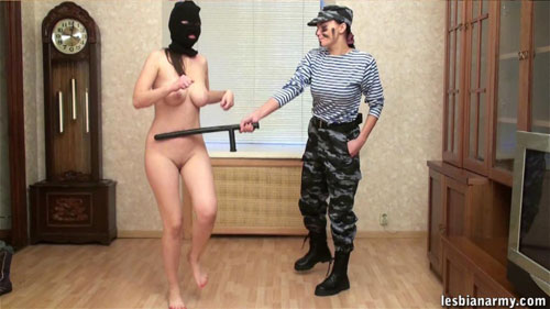 Masked army babe jumps under baton control