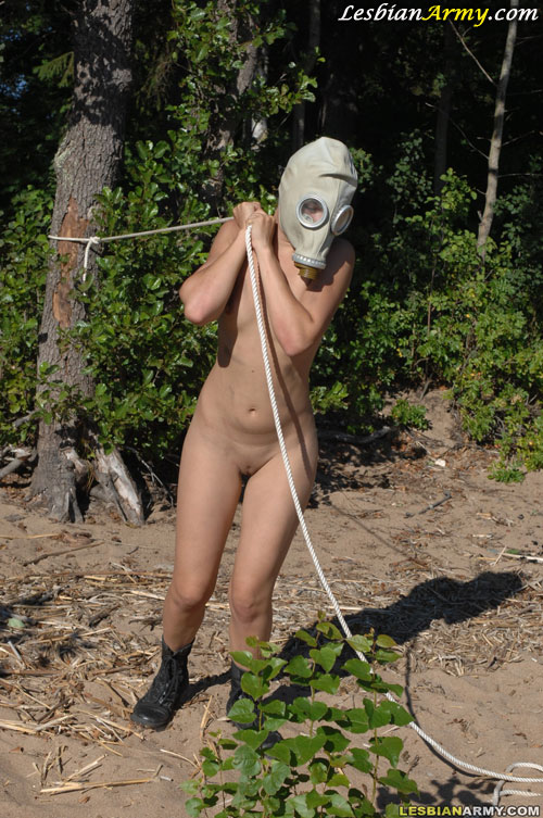 Army babe in gas mask does outdoor nude exercises
