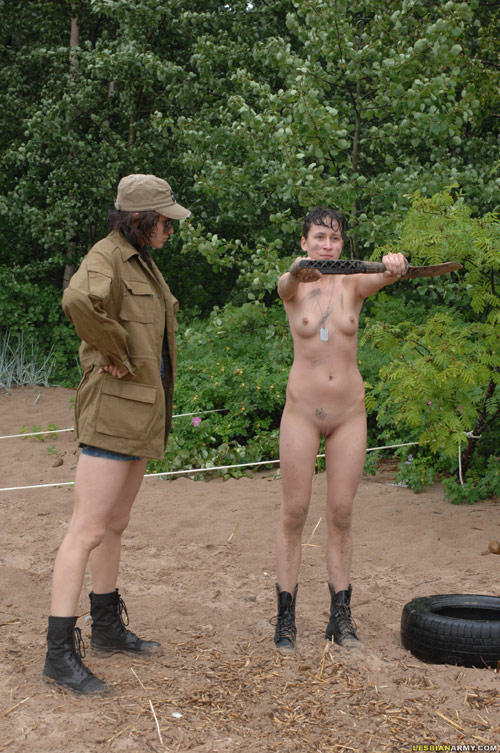 Nude teen army girl exercises with a shovel