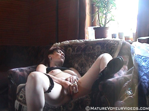 Mature toying on spy camera