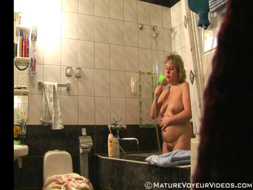 Fat mature woman voyeured in the shower