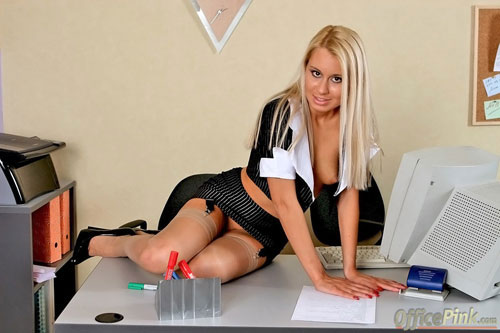 Smiley blonde secretary poses on the table