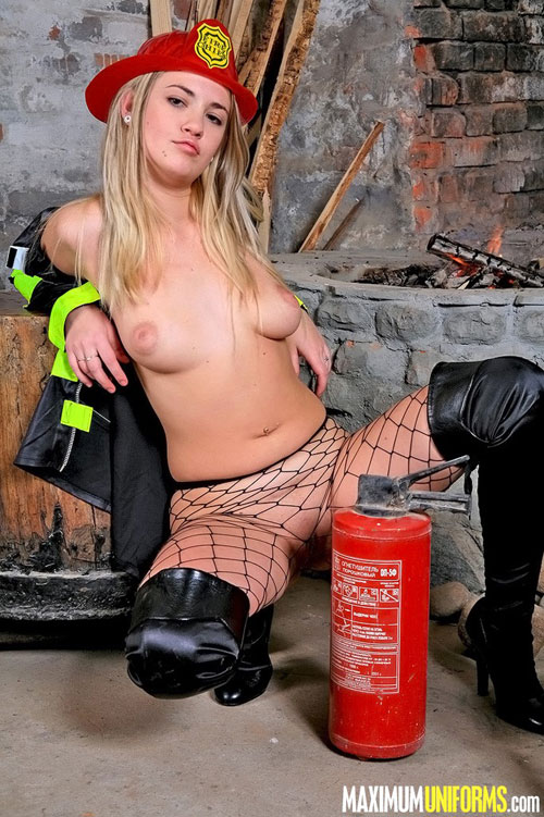 Nude boobs of a fire girl in fishnet pantyhose