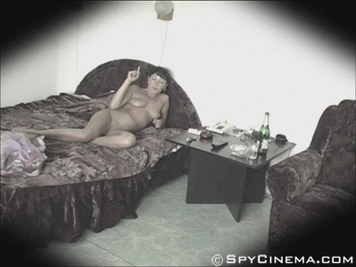 Smoking naked girl on a spy bedroom camera