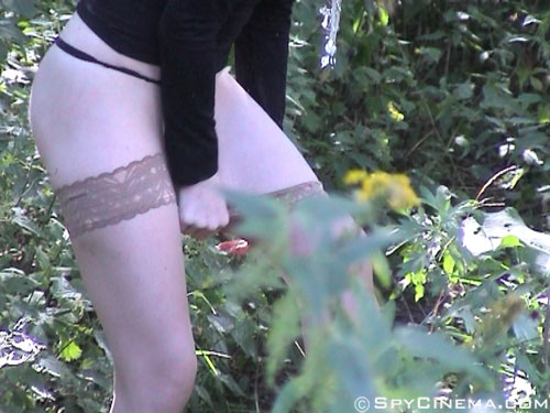 Outdoor spying on stockings pulling