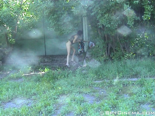 Outdoor spycam view of a changing babe
