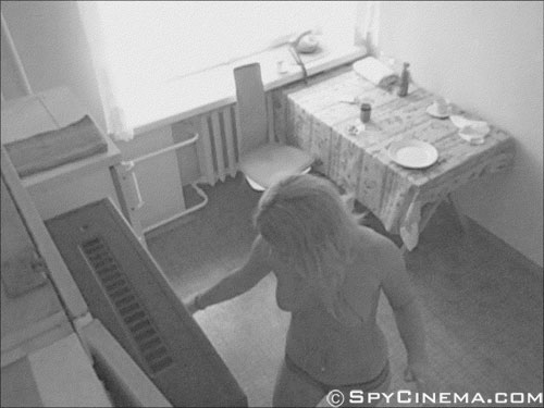 Naked girl on a kitchen spy camera
