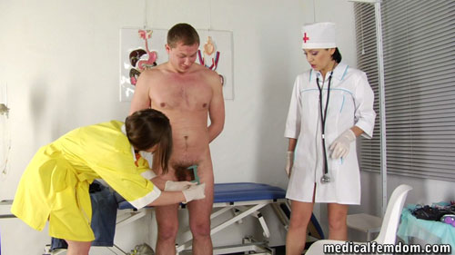 Measuring a submissive penis at a CFNM femdom medical exam
