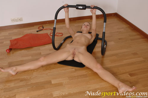 Wide-legged exercises with a naked fitness rocker