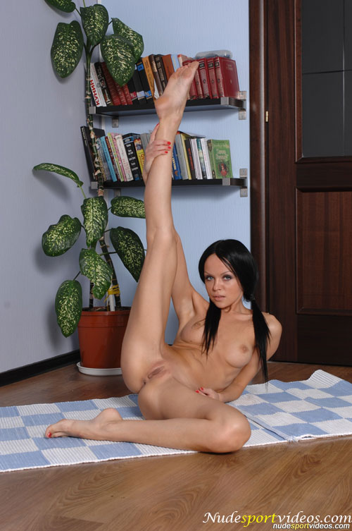 Sexy side leg stretching by a hot nude gymnast girl