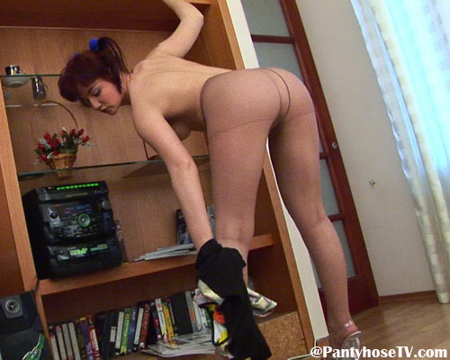 Nice legs in tan pantyhose of a topless babe