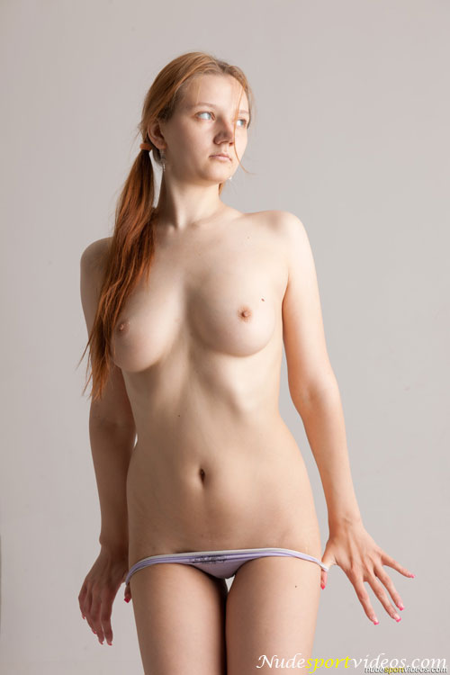 Big-titted redhead babe Elena V. pulling down her panties