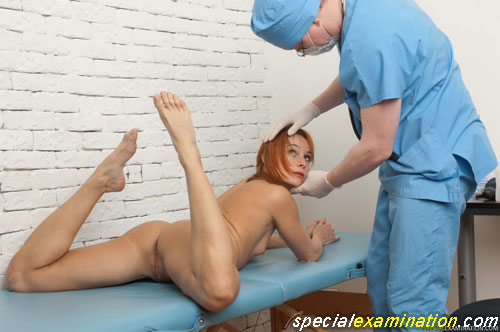 Flexible nude babe going to perform a yoga asana at the medical exam
