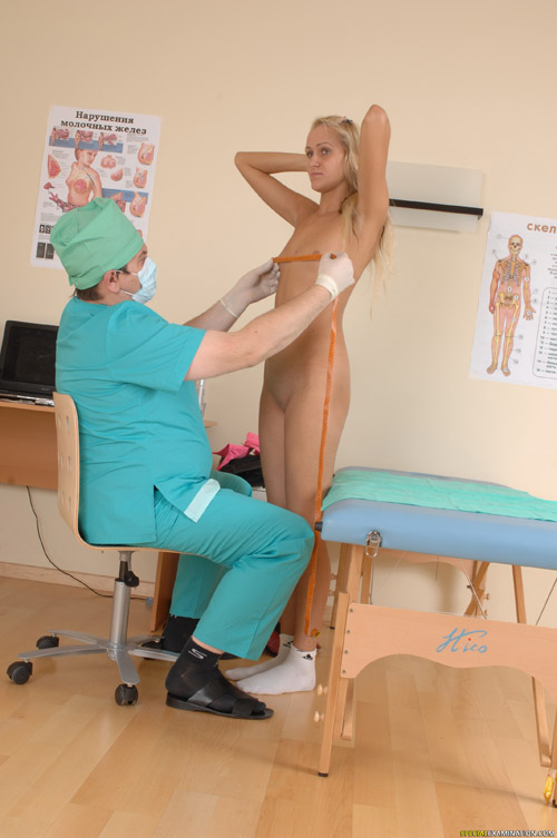 Breast measuring at a nude medical exam