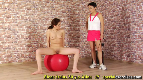 Lesbian trainer makes a fitness nude slave masturbate on the fitball