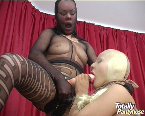 Lesbian strapon fucking in pantyhose suits